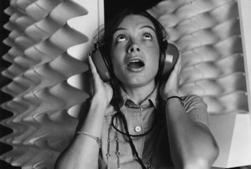 1st  August 1972:  Christine Harris wearing Auralgard II Ear Defenders during an exhibition at the Design Centre in London.  (Photo by Peter King/Fox Photos/Getty Images)