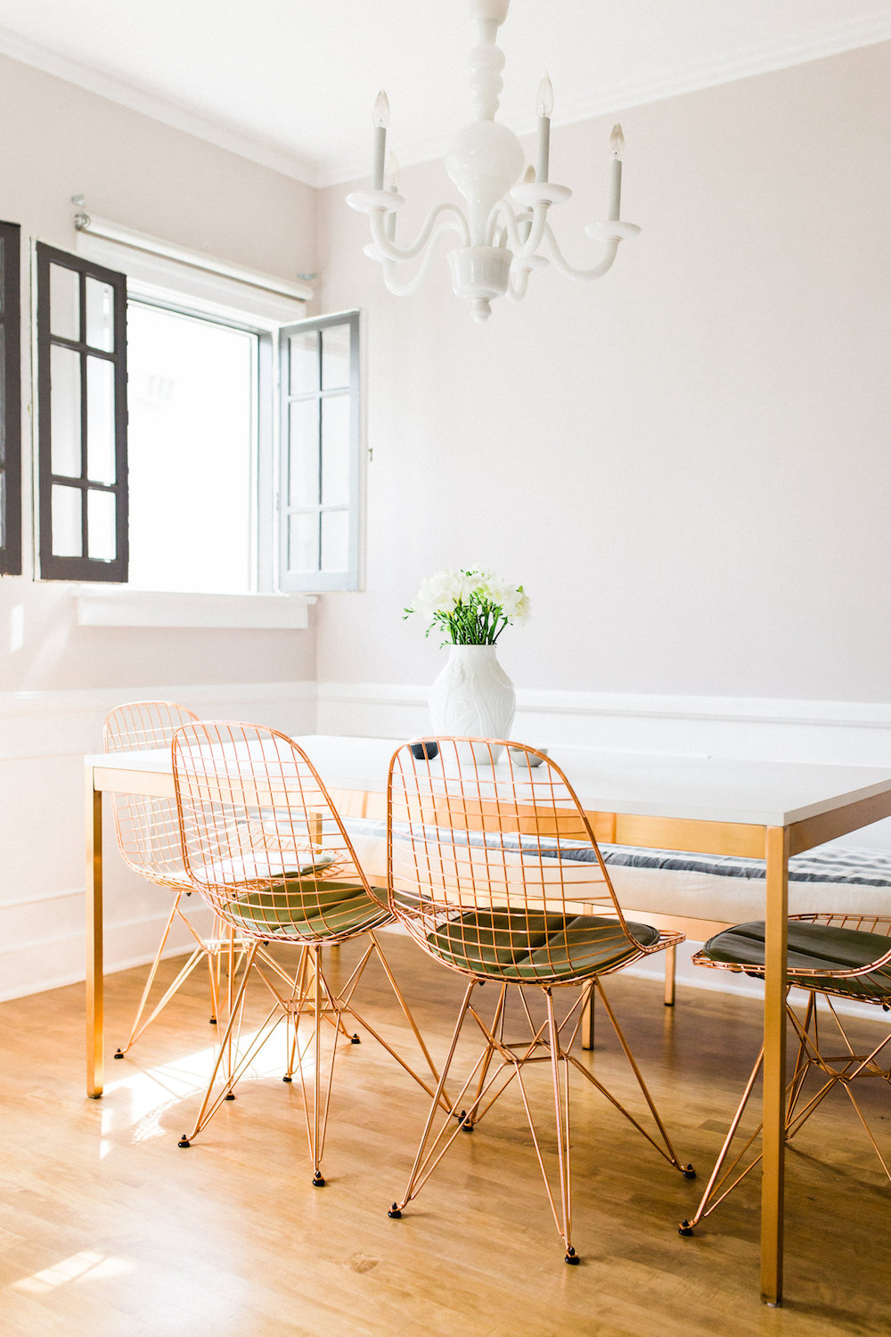 Table and bench: handmade. Chairs: Modernica . Chandelier: Martha ...