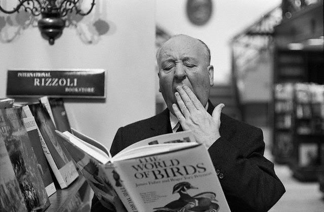 Alfred Hitchcock reading a book
