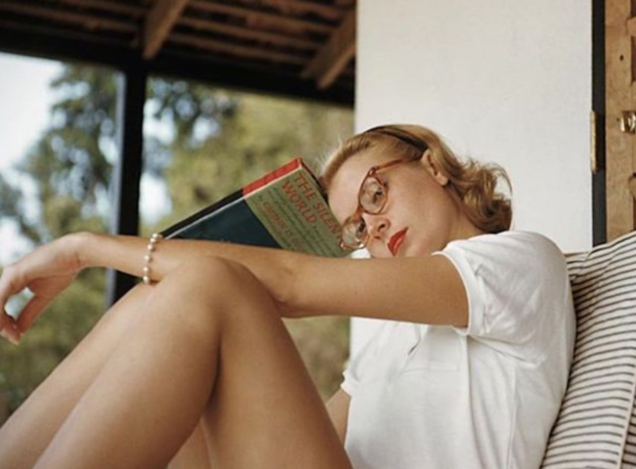 Grace Kelly reading a book