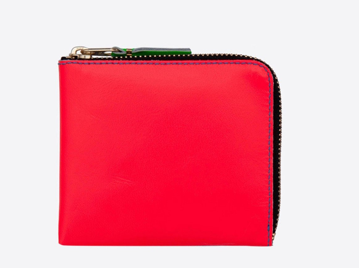 53efd221d1 Wallet: When you carry a black bag, and wear black sweaters, and pull on  black boots, sometimes you crave a pop of color. I love this cheerful neon  wallet, ...