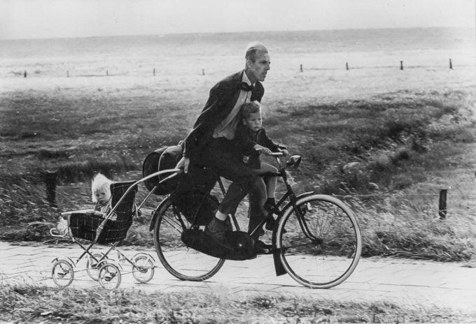 Dad biking with kids