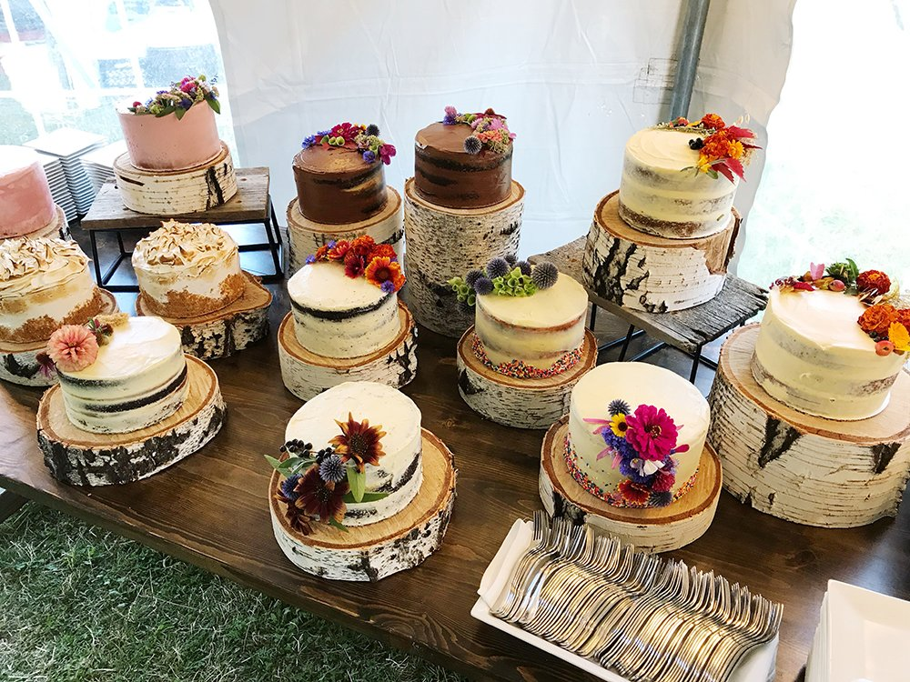 naked wedding cakes with wildflowers