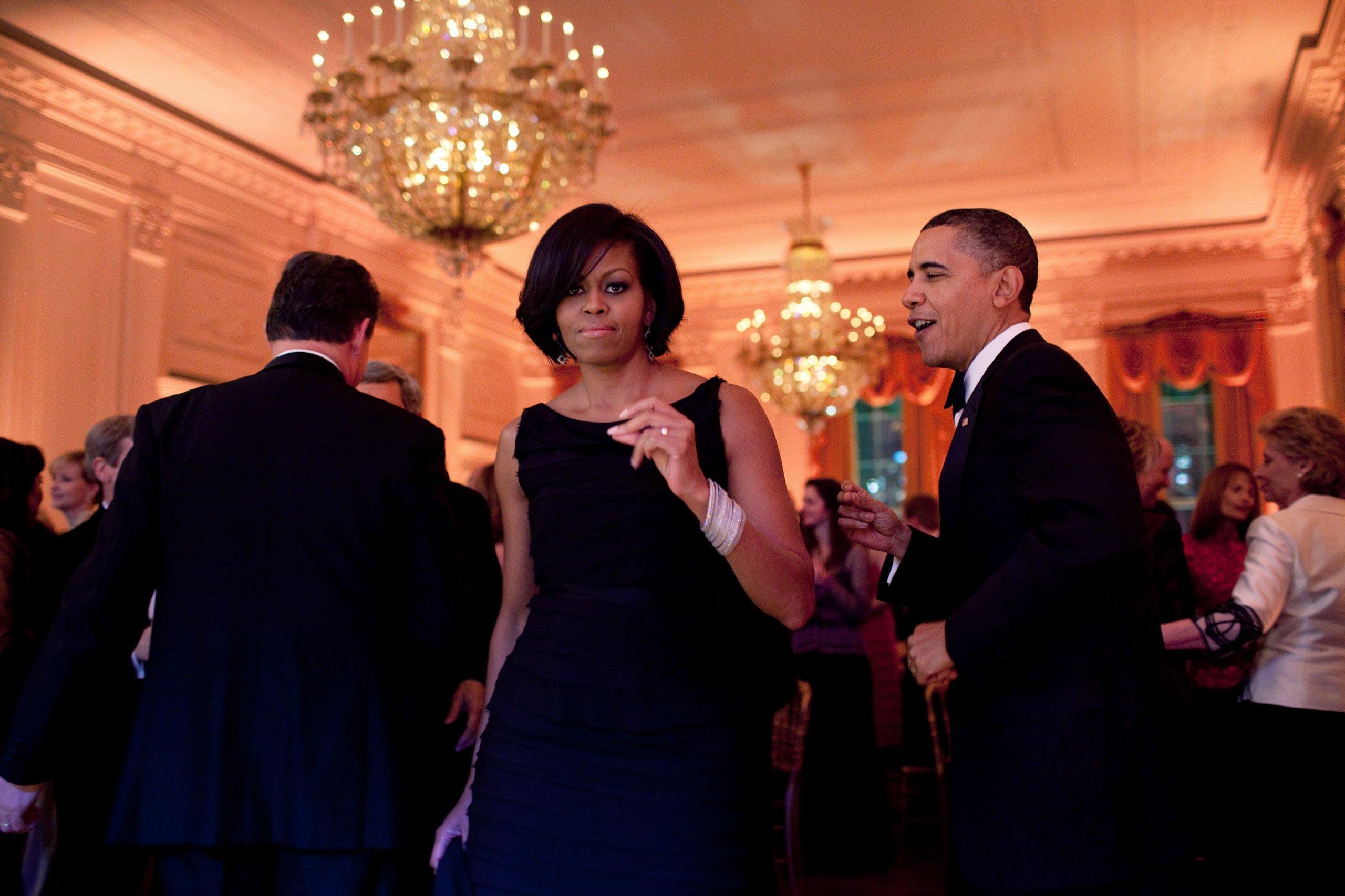 Michelle Obama dancing with Barack Obama