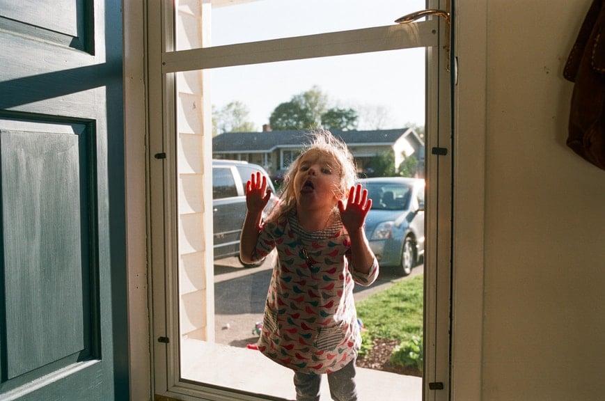 little girl at door