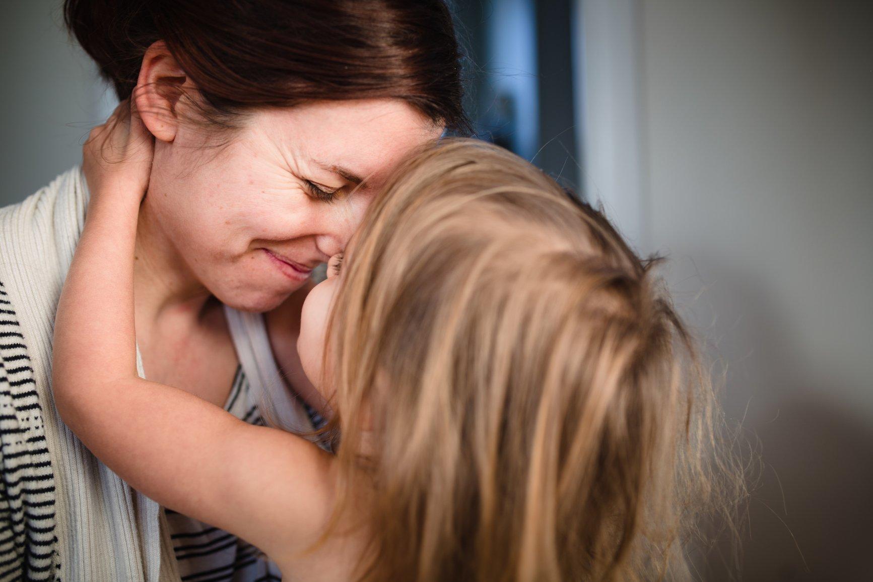 mother hugging child